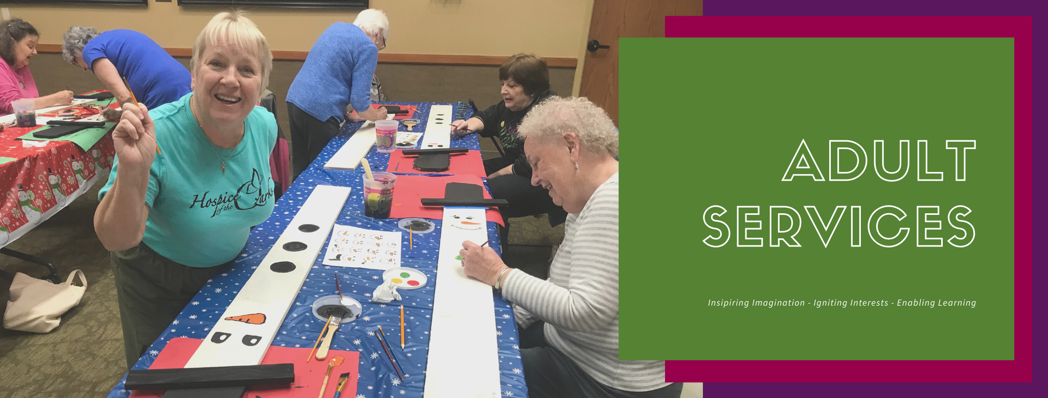 Adults painting at snowman painting class